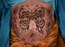 butterfly henna belly design