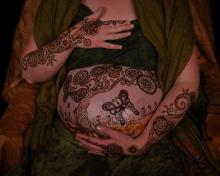 henna body art design of a flowering tree and butterfly ~ honoring pregnancy with henna tattoos