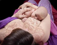 flowers and spirals across her breasts and sweet new baby nurses